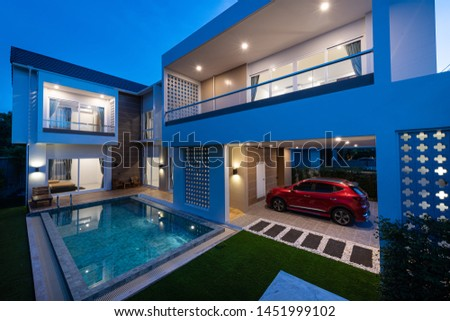 PHUKET, THAILAND - JULY 6 : Exterior Modern Tropical Villa with Swimming Pool for a new family on JULY 6, 2019, in Phuket Thailand. #1451999102