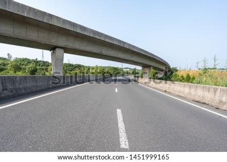 empty asphalt road in park #1451999165