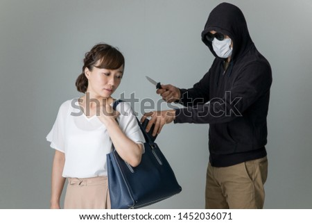 Image of a criminal and the woman #1452036071