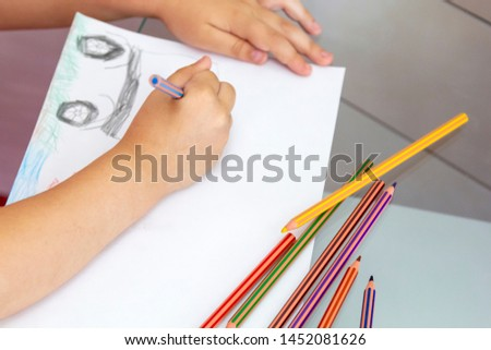 Child draws with colorful pencils. Children's drawing on theme of fishing with goldfish, car #1452081626