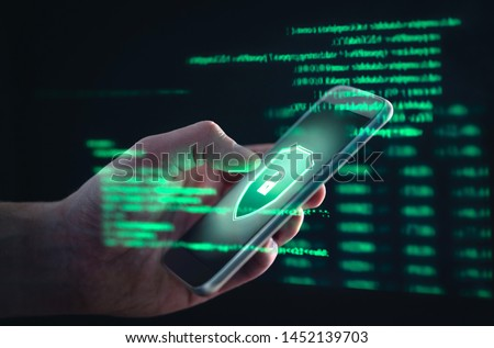 Phishing, cyber security, online information breach or identity theft crime concept. Hacked phone. Hacker and cellphone with hologram data. Mobile scam, fraud or crime. Cybersecurity infringement. Royalty-Free Stock Photo #1452139703