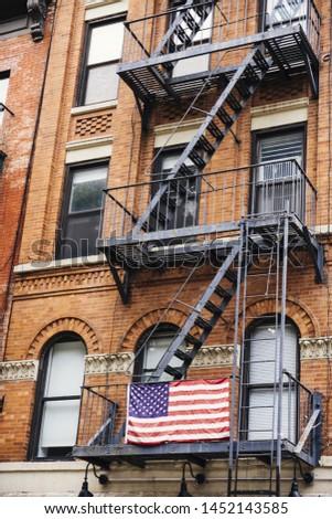 Fire escape with USA flag #1452143585