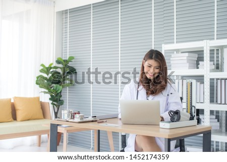 Asian woman doctor sitting in the office #1452174359