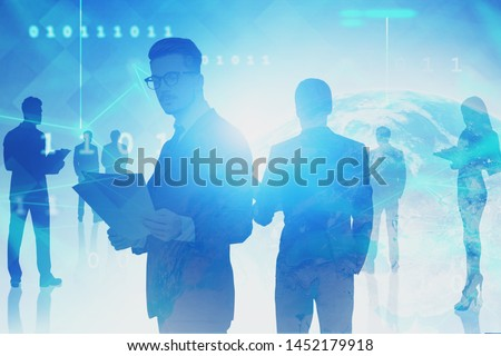 Business people silhouettes over blue background with Earth hologram and network interface. Concept of hi tech. Toned image double exposure. Elements of this image furnished by NASA #1452179918