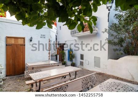 IBIZA,SPAIN-OCTOBER 10,2019: Typical street in historic center, Dalt Vila of Ibiza, Eivissa, Balearic Islands. Spain. #1452255758