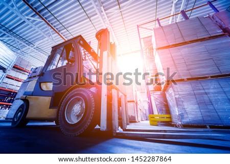 Forklift loader in storage warehouse ship yard. Distribution products. Delivery. Logistics. Transportation. Business background #1452287864