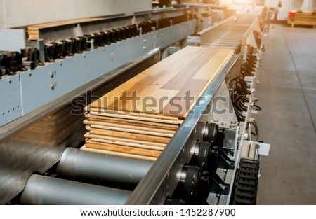 Production line of the wooden floor factory. CNC automatic woodworking machine. Industrial background #1452287900