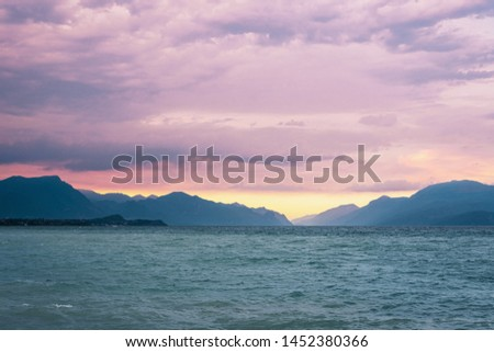 Lake Garda, Italy travel landscape. Lake and mountains during sunset. #1452380366