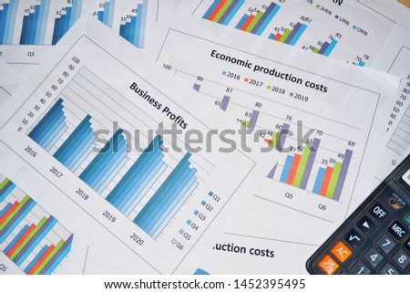 Business work, document data, graphs, graphs, marketing reports, research, development and planning for management, strategy analysis, financial accounting Business concepts in the future world #1452395495