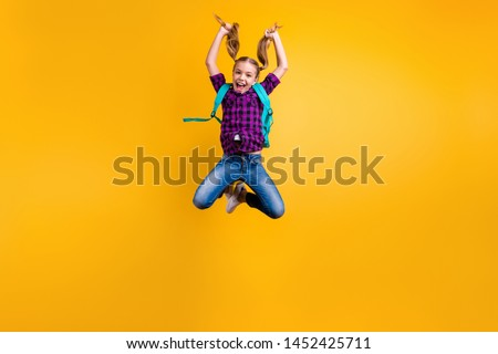 Full body photo of little pupil jump high finally holidays wear casual checkered shirt jeans denim isolated yellow background #1452425711