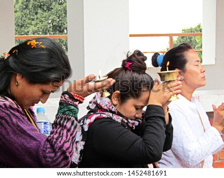Chandragiri, Nepal - April 11 2018; Three women holding a candle for a religious ritual in Chandragiri, Nepal on April 11 2018 #1452481691