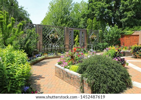 CHICAGO, IL/USA - JULY 8, 2019: The beautiful Chicago Botanic Garden in the summer, which is free to visitors.  You just pay a lot to park your car. #1452487619
