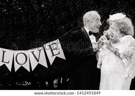 forever in love concept. wedding anniversary decoration. elder couple wedding portrait.  love in age. wedding concept. old bride and groom. fifth golden wedding anniversary. everlasting true love.  #1452491849