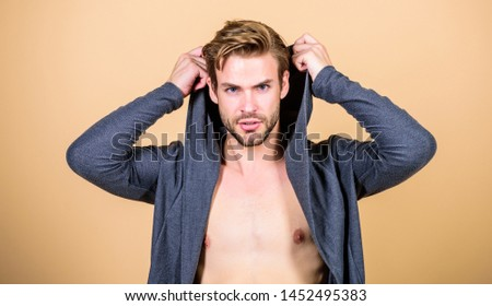 Masculinity concept. Masculinity and confidence. Man muscular torso wear hooded clothes. Brute masculinity extremely commanding looking conventionally handsome. Unconventional but masculine look. #1452495383