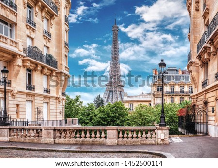 Small Paris street with view on the famous Eiffel Tower in Paris, France. #1452500114
