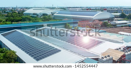 Architectural detail of metal roofing on commercial construction Solar panels or Solar cells on factory rooftop or terrace with sun light, Industry. Royalty-Free Stock Photo #1452554447