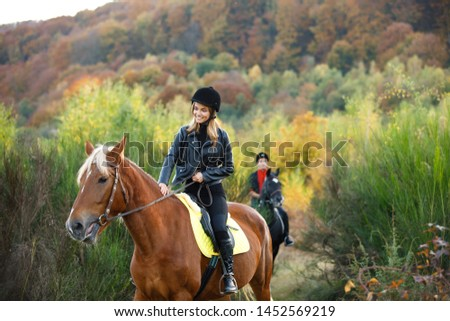 man and girl riding on separate  horses in mountains with amazing view. couple in love riding horses. professional jockeys. walk to remember on horses. couple equitation on black and brown horses.  #1452569219