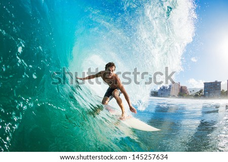 Surfer on Blue Ocean Wave Getting Barreled Royalty-Free Stock Photo #145257634