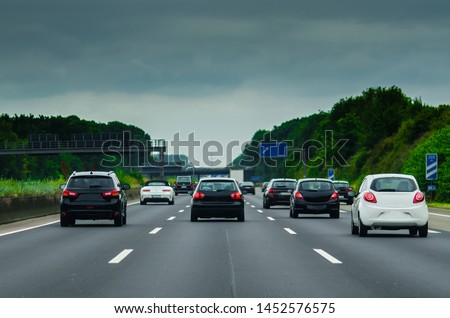 Black cars and white cars on the german autobahn Royalty-Free Stock Photo #1452576575