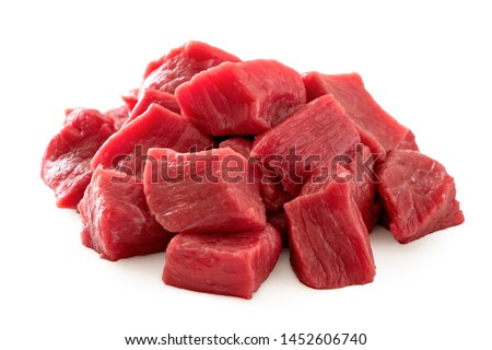 Pile of beef cubes isolated on white. Royalty-Free Stock Photo #1452606740