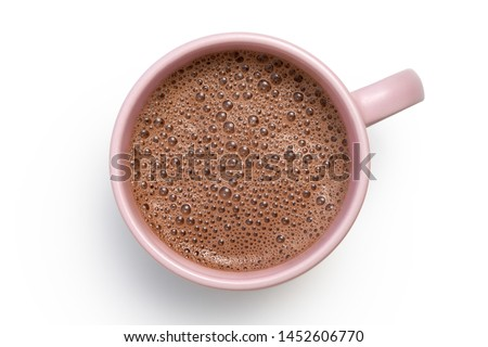 Hot chocolate in a pink ceramic mug isolated on white from above.