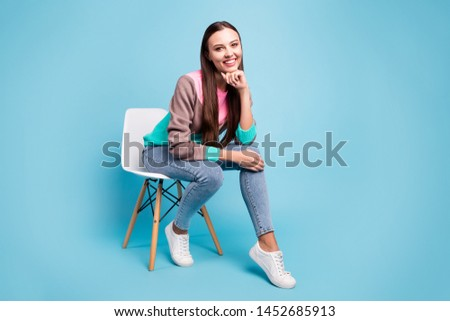 Full length photo of charming awesome winsome lady having pause and break sitting on modern light chair isolated bright background