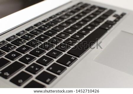 detailed laptop keyboard on white background #1452710426