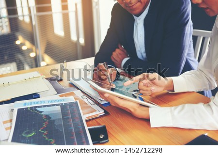 Two businessmen are consulting and planning business operations. Royalty-Free Stock Photo #1452712298