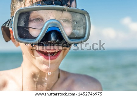Closeup of boy face in the snorkeling mask and tube. Travel and summer concept. Сhildren's diving #1452746975