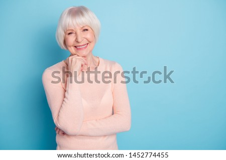 Portrait of her she nice-looking attractive lovely kind well-groomed cheerful cheery glad content gray-haired lady enjoying healthy life isolated on bright vivid shine blue green turquoise background #1452774455