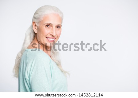Portrait of charming person looking at camera smiling wearing turquoise jumper isolated over white background #1452812114