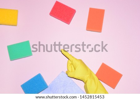 rubber glove yellow finger shows the place free on a pink background cleaning #1452815453