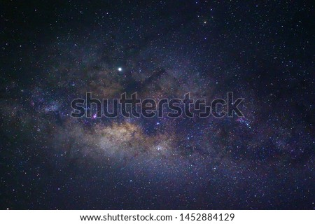 Clearly Milky Way Galaxy in the night sky. Image contains noise and grain due to high ISO. Image also contains soft focus and blur due to long exposure and wide aperture #1452884129