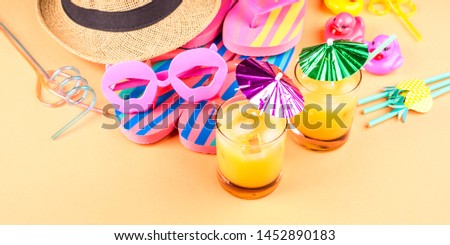 Vacation on the beach concept with colorful summer cocktails and beach accessories - hat, flip flops, sun glasses #1452890183