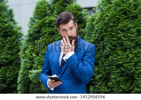 Looking great. agile business. bearded man on business meeting. using modern technology. modern look of ceo. responding email. always online. charismatic businessman with smartphone. #1452906596