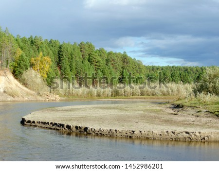 Erosion erosion of the sandy shore of a small Northern Yakut river in the wild Northern taiga in a picturesque spruce forest. #1452986201