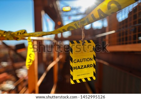 Yellow caution sign/ symbols tag applying on the entry construction workplace to ensure safety warning precaution in place from public access construction site Sydney