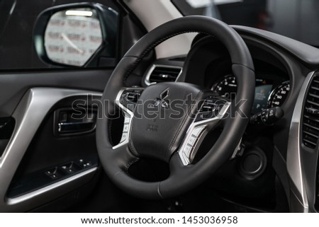 Novosibirsk, Russia – June 30, 2019:  Mitsubishi Pajero Sport, close-up of the dashboard, player, steering wheel, accelerator handle, buttons, seats. modern car interior: parts, buttons, knobs #1453036958