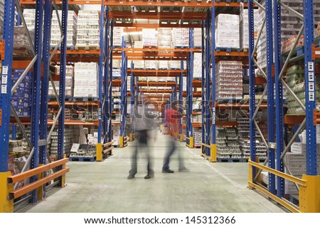 Blurred men walking in the warehouse #145312366