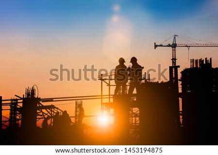 Silhouette of engineer and construction team working at site over blurred background for industry background with Light fair. #1453194875