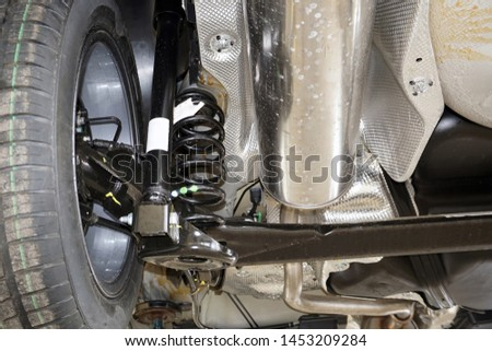 Rear suspension of a modern car. Elements and design of the rear suspension. Rear suspension beam, spring, shock absorber.                       #1453209284