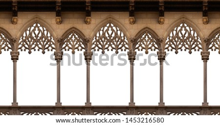 Elements of architecture of buildings, ancient arches, columns, windows and apertures. On the streets in Catalonia, public places. Royalty-Free Stock Photo #1453216580