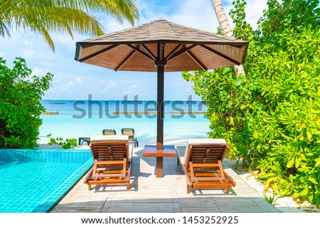 beach chair with swimming pool and sea beach background in Maldives #1453252925