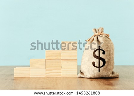 business image of a sack with money over wooden desk #1453261808