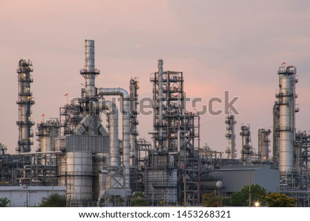 Oil refinery and petrochemical plantin dustry, refinery factory, natural gas storageetank at twilight #1453268321