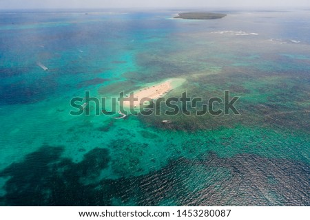 Naked Island, Siargao. The island of white sand on the atoll. Tourists relax on the white island. Seascape with sandy island. #1453280087