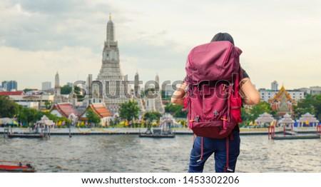 A traveler traveling into Wat Arun Ratchawararam Ratchawaramahawihan Temple in bangkok, Thailand  #1453302206