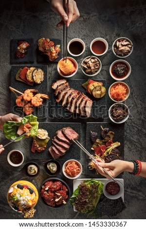 Korean food for a brunch with friends top down view Royalty-Free Stock Photo #1453330367