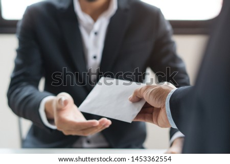 Close up view of  office worker receiving salary from boss. #1453362554