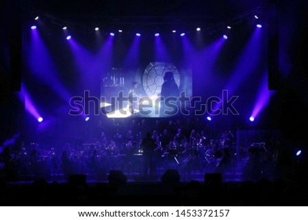 ODESSA, UKRAINE - July 16, 2019: A concert by the symphony orchestra of Andrey Cherny on the theater stage of the Odeskogot Opera Theater. Symphony orchestra musicians perform OSCAR cinematic hits #1453372157